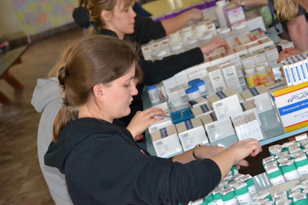 Emily (one of our pharmacy residents at Grandview...helping out with med packing!)