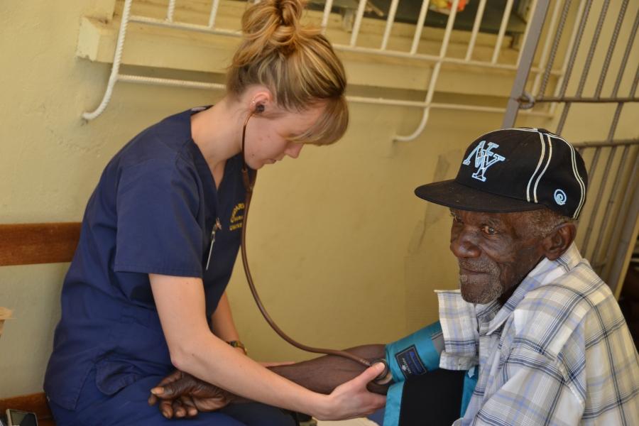 Ella taking a blood pressure during triage.