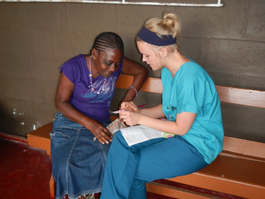 Kassandra counseling a patient on how to take her medicine.