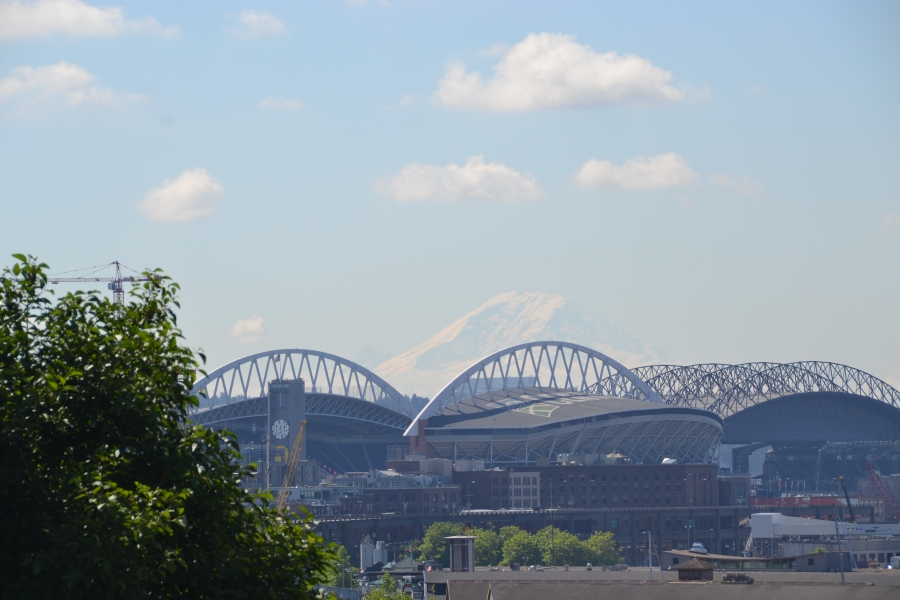 Mt. Rainier in the distance behind the stadiums.