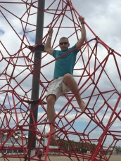 Dustin checking out the kids play gym at the beach
