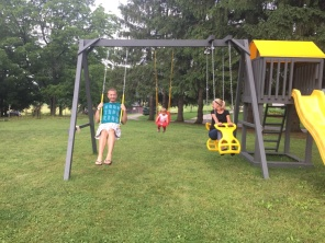 The Hartzler kids on the new swing-set