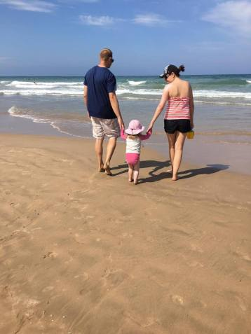 Walking on the sand with Mom and Dad