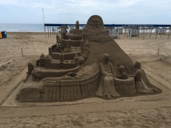 An amazing Sand Castle on the beach, Jesus and the Woman at the Well.
