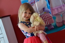 Posing with her favorite doll!